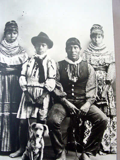 The Brighton Seminole family poses for this photo in the early 1900s dressed in traditional Seminole garments.